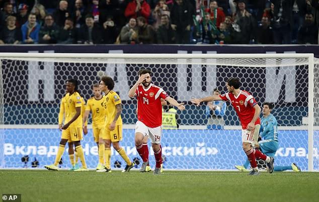 GeorgiDzhikiya (centre) celebrates after he scored a consolation goal for Russia vs Belgium