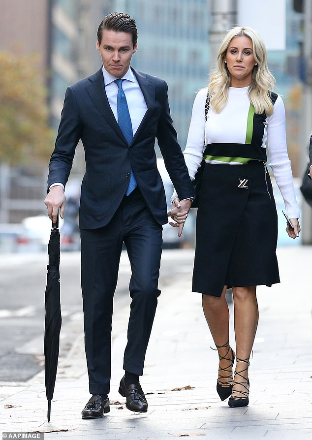 Roxy Jacenko walks down the street with her husband Oliver Curtis