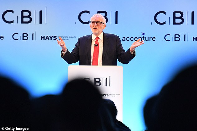 Jeremy Corbyn, pictured addressing the CBI after Mr Johnson, said he would not be making 'any apologies' for Labour's nationalisation plans