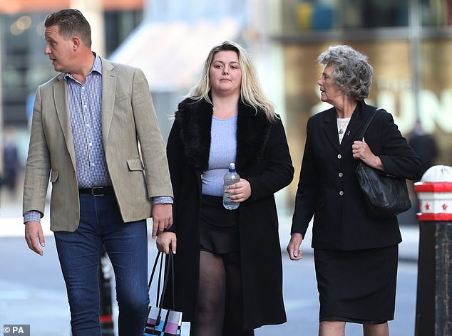 Jodie Chesney's sister Lucy (pictured, centre, outside court) has given an emotional statement to court ahead of the girl scout's killers sentencing today