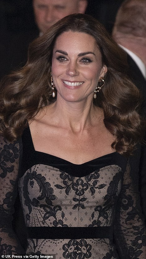 Catherine, Duchess of Cambridge, wore a pair of eye-catching earrings and kept the rest of her jewellery to a minimum, sporting only her engagement ring