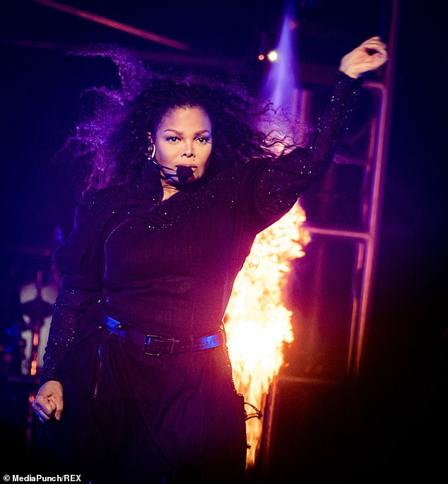 Wow: With red-hot flames blazing in the background, the Escapade hitmaker appeared in her element as she threw her hands up in the air