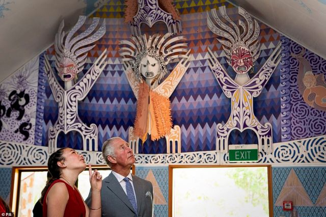 The royal appeared to be enthralled by the colourful wood carvings during the visit on the seventh day of the tour