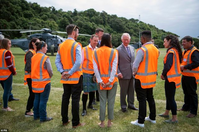 The Prince of Wales talked with the Orange Army, who helped to rebuild the local roads after the earthquake, in Kaikoura
