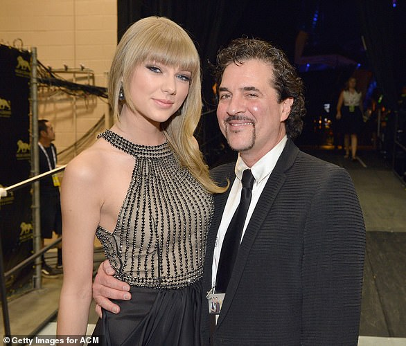 Long working relationship: Taylor Swift signed with Big Machine Records in 2006, which released all of his albums except one; she is seen with Scott Borchetta in 2013