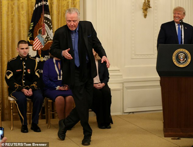 Dancing in the White House: On November 21, Voight was awarded the National Medal of Arts by the 74-year-old politician (R), who called his 1969 gay hustler film Midnight Cowboy 'a great movie'