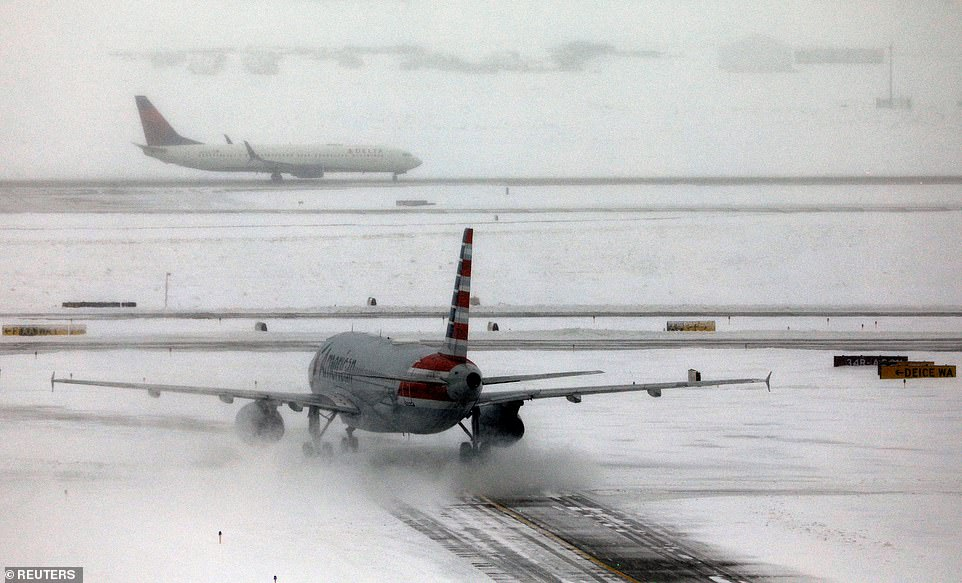 Thousands of passengers were stranded at the Denver International Airport (pictured) overnight as power outages, widespread road closures and huge pileups on icy roads, add to the mix of travel chaos for millions ahead of the Thanksgiving holiday. A total of 491 flights in and out of the Denver airport were canceled and more than 700 flights were delayed