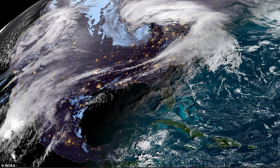 A satellite view of the storms battering the US on Wednesday morning as bad weather causes travel chaos for millions