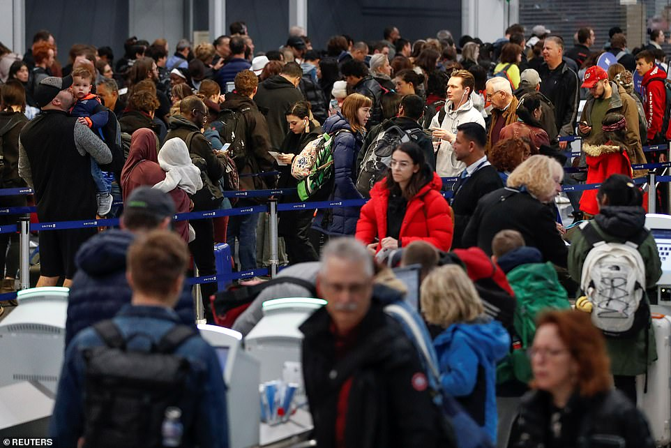 Travelers queue during the Thanksgiving holiday travel rush at O'Hare Airport in Chicago, Illinois on Wednesday