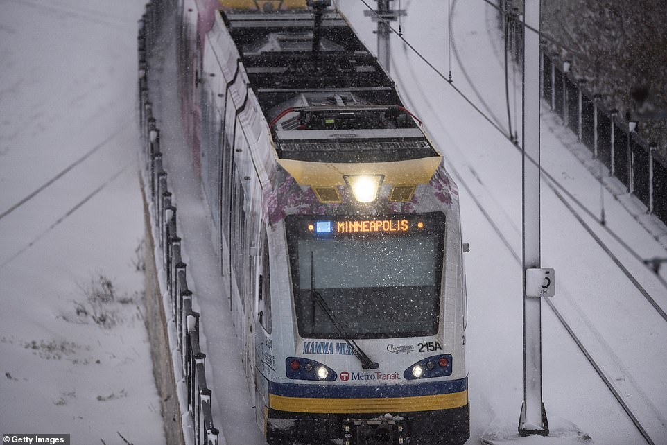 A Metro Transit light rail train heads toward downtown as snow continues to fall after a blizzard struck Minneapolis. The treacherous weather jeopardized travel plans for some of the 55 million Americans expected to fly or drive at least 50 miles from their homes for Thursday's Thanksgiving holiday, according to the American Automobile Association