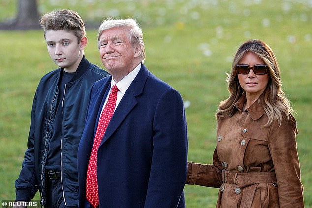 President Donald Trump walks with son Barron and first lady Melania Trump as they depart for travel to Florida from the South Lawn of the White House