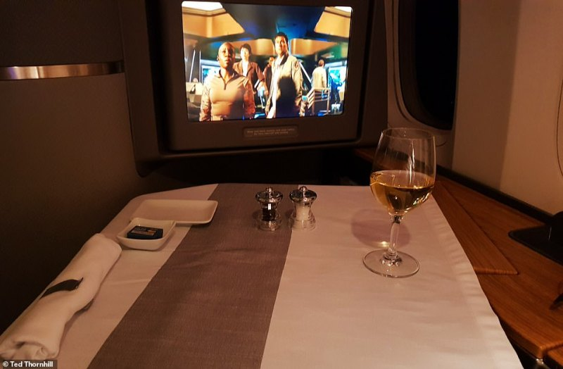 Delightful dining: The cabin crew convert Ted's suite into a mini restaurant table in the air