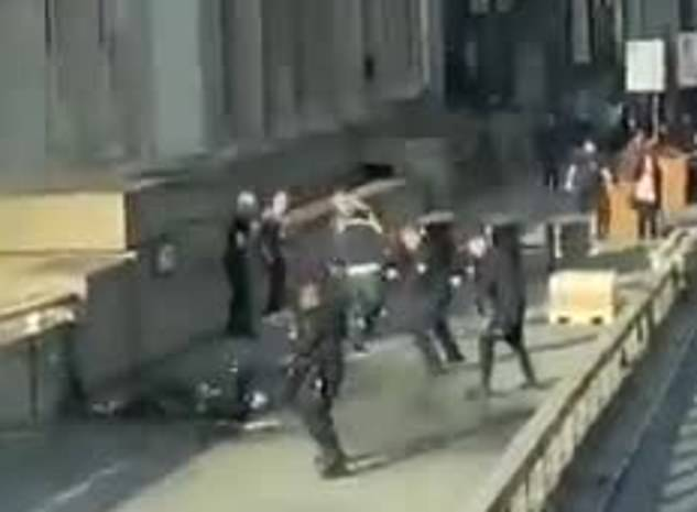 Video filmed at the scene shows at least four people struggling with a man at London Bridge