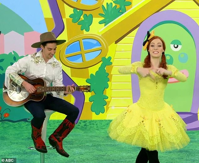 Co-workers:Oliver plays various instruments on The Wiggles, including guitars and banjo, and has previously joined the band on several of their world tours.Emma confirmed her relationship with Oliver in December 2019, saying it was 'new' at the time