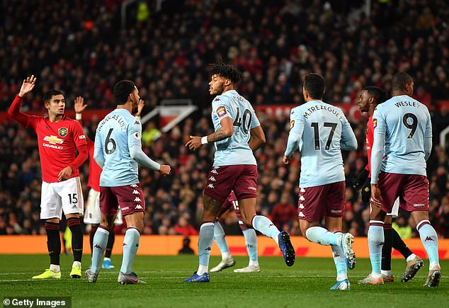 Tyrone Mings celebrates his villa friends after he has done 2-2 Sunday night