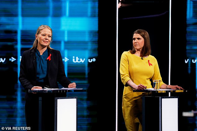 But the leader of the Liberal Democrats, Jo Swinson (right) interrupted him and said: 'That is what you do on a night out after a drink?