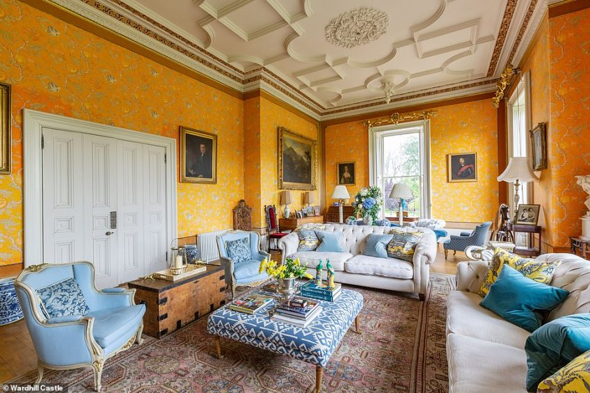 Wardhill Castle has a selection of reception rooms, a 'contemporary farmhouse-style' kitchen and a lavish dining room