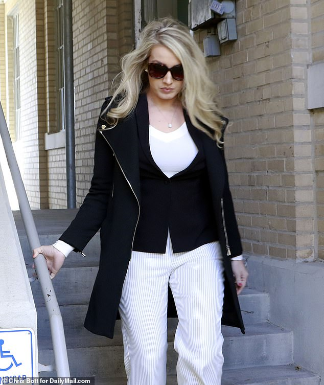 Hunter Biden's baby mama Lunden Roberts, 28, looked glamorous as she left court in Batesville, Arkansas on Monday morning. She wore a black zip-up coat over a white top and a pair of white pinstripe pants. Her long blonde hair cascaded halfway down her back