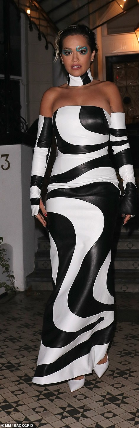 Stepping out:She added sharp white heels to the outfit