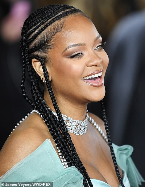 Stunning: The songstress worked her raven-coloured hair into long braids