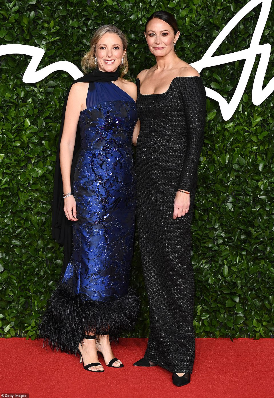 Camera, action: Farfetch Chief Strategy Officer Stephanie Phair (L) and Chief Executive of the British Fashion Council Caroline Rush, who wore Emilia Wickstead, walked the carpet together
