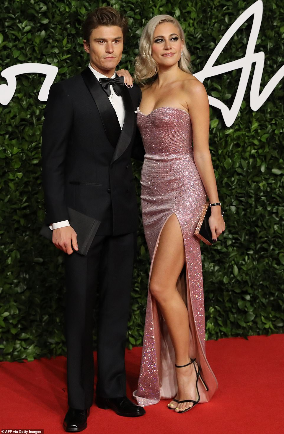 Model couple: English model Oliver Cheshire looked dapper in a bespoke Jack Davison suit, while his fiancée Pixie Lott wore a custom Philosophy di Lorenzo Serafini strapless Swarovski crystal embellished gown