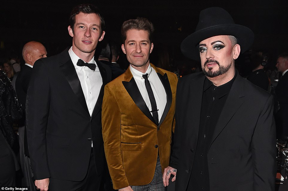 Catching up: Boy George joined Callum Turner (L) and Matthew Morrison for the event