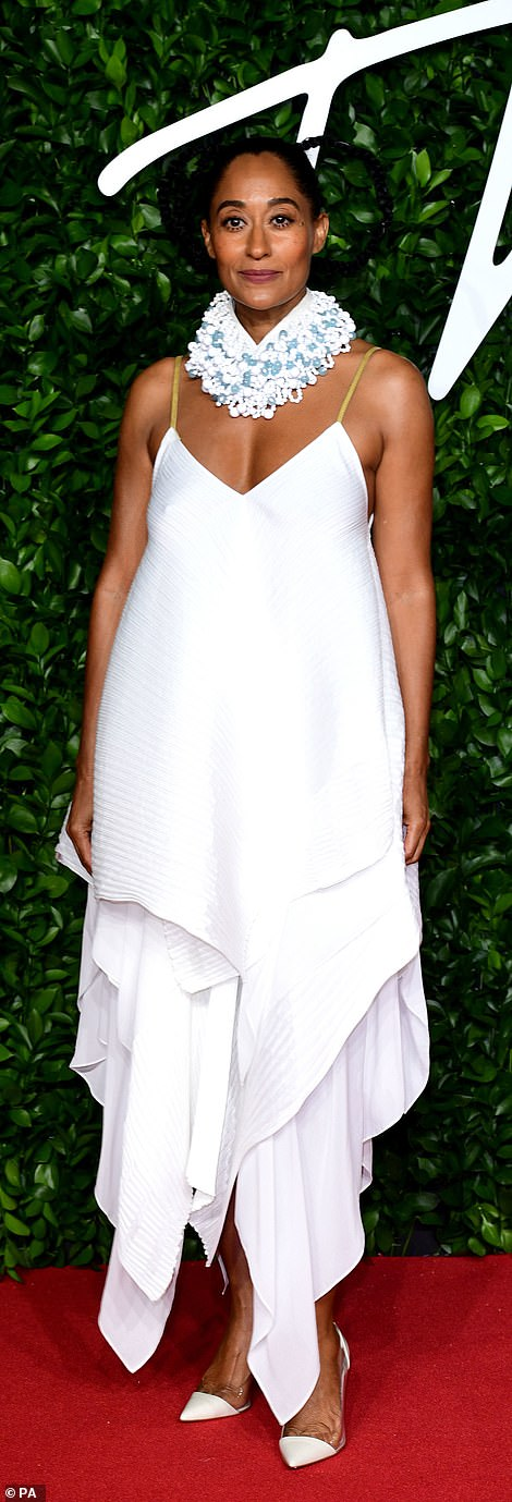 Same, same: Amber Valletta (L) and the event's presenter Tracee Ellis Ross sported striking white dresses for the evening