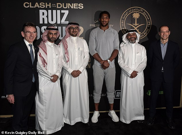The Briton (middle) has been criticised for giving his approval of Saudi Arabia as a fight venue