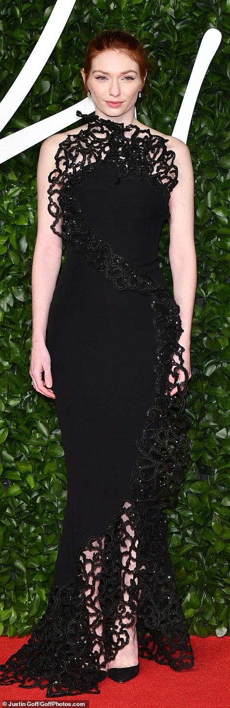 Figure-hugging: Eleanor Tomlinson stunned in her striking black form-fitting look