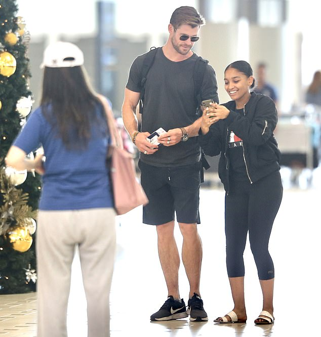 Say Cheese! Chris Hemsworth proved on Tuesday that he is a man of the people when he posed for photos with fans when leaving Brisbane Airport
