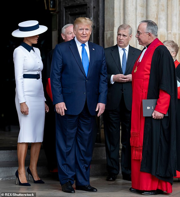 Trump and the First Lady are pictured greeting members of the church outside Westminster Abbey in June, with Prince Andrew just behind them
