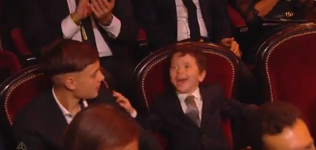 The four-year-old was laughing hysterically in his seat as Messi collected his award