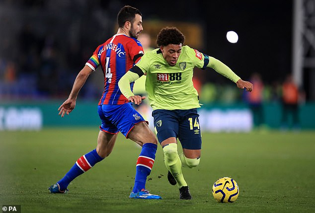 Crystal Palace's Luka Milivojevic and Bournemouth's Arnaut Danjuma (right) battle for the ball
