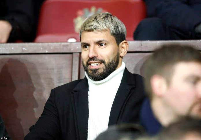 The injured Sergio Aguero watches on from the stands at Turf Moor as his team tried to pick up three points without him