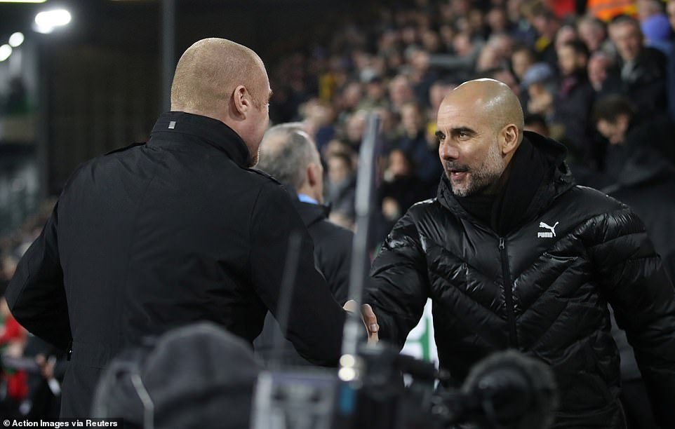 Sean Dyche shakes hands with his opposite number Pep Guardiola ahead of the game on Tuesday night at Turf Moor