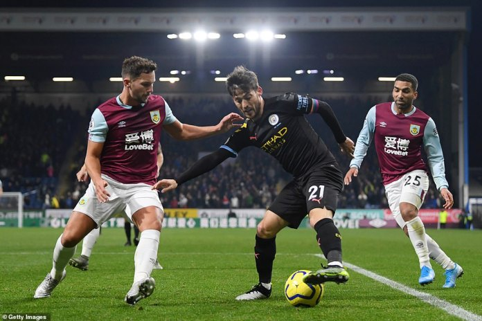 Silva (centre) tracked by Burnley midfielder Danny Drinkwater (left) and forward Aaron Lennon (right) on Tuesday evening