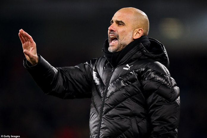Guardiola bellowed out instructions to his players as he looked to increase City's lead during the first-half at Turf Moor