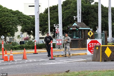Security stand outside the main gate at Joint Base Pearl Harbor.A U.S. sailor shot three civilian Department of Defense employees at the Pearl Harbor shipyard Wednesday before taking his own life, the military said