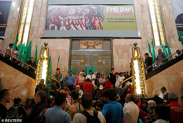 A group of people, who are part of a farm union, block the entrance of the Fine Arts Palace to protest against a painting showing Mexican revolutionary hero Emiliano Zapata nude