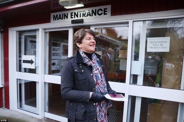 DUP leader Arlene Foster arrives at a polling station in Enniskillen, in Northern Ireland, to cast her vote