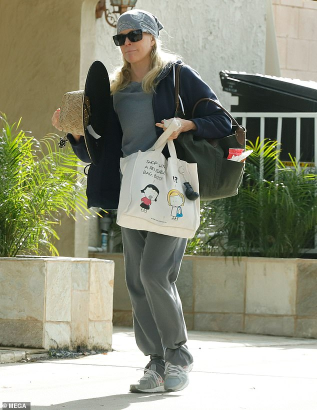 So casual:The 8 Mile actress, 65, donned a baggy grey tracksuit and and carried a plethora of accessories as she made her way into the building