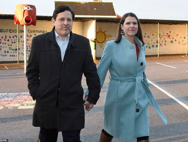 Liberal Democrat leader Jo Swinson and her partner Duncan Hames arrive to cast their votes at Castlehill Primary School in Glasgow this morning