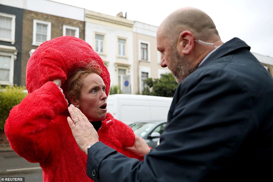 The woman in fancy dress is seen arguing with security and police, appearing to be outraged at being held back from Mr Corbyn, who said: 'Hello guys, can we stop the arguments please'