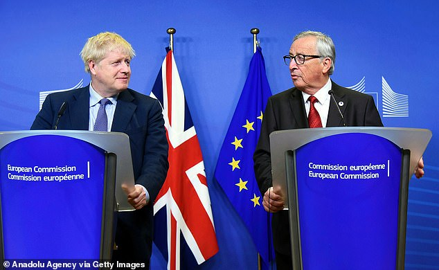 New deal:Mr Johnson struck a revised Brexit deal with Brussels earlier this year, removing the much-derided 'backstop' from the agreement reached by Theresa May