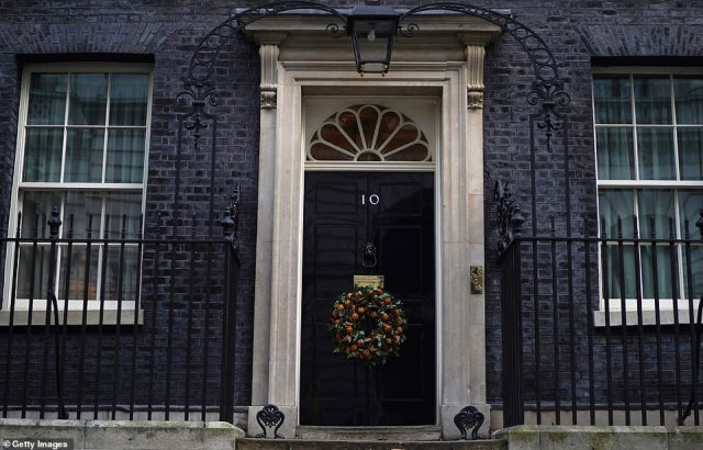 The prize: Either Boris Johnson or Jeremy Corbyn will be speaking in front of 10 Downing Street's famous black door (pictured) after the first December general election since 1923