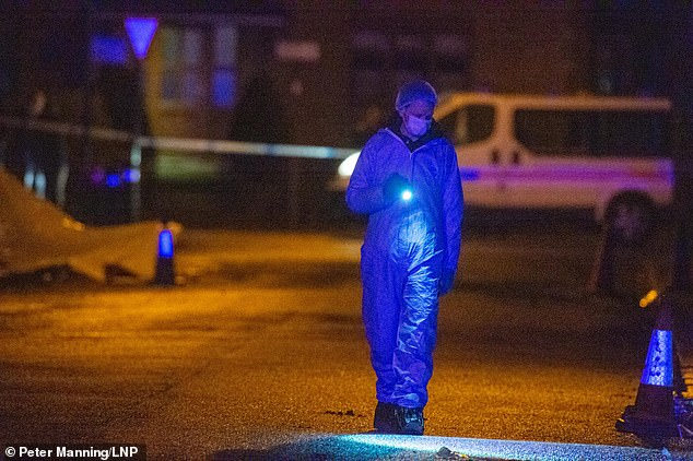 Forensic investigators are at the scene of the stabbing in Brent where one man was killed and another injured