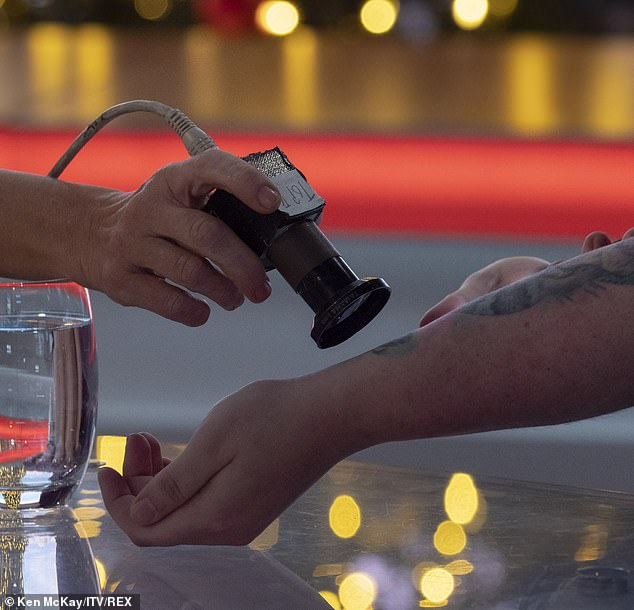 LED lights embedded in her forearm (pictured) are activated by a magnet and shine through her skin. This is one of a number of gimmicks available to 'transhumanists' who like to 'upgrade' their bodies