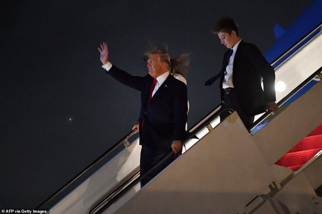 "22522446 7815917 image a 50 1576909983701 The first family landed in their Mar-a-Lago residence in Palm Beach on Friday after departing the White House for the Christmas holiday. Barron Trump was photographed alongside his parents towering over his 6""2 father."