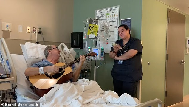 A video has gone viral of musician Penn Pennington, 67 (left), a chemotherapy patient from Nashville, Tennessee, and nurse Alex Collazo, 24 (right), singing O Holy Night
